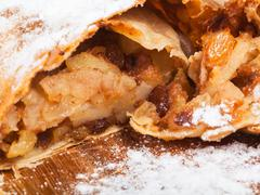 Sweet stuffing in apple strudel pie close up Stock Photos