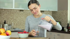 Young brunette woman drinking strawberries milk shake HD Stock Footage