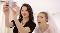 bride and her friend take selfie - stock footage