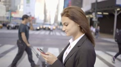 Young women using smart phone tablet computer outdoors. shot on red epic Stock Footage