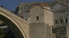 People on Stari Most, Tara tower and mountains in Mostar Stock Footage