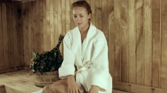 Girl in a bathrobe steamed in the bath Stock Footage