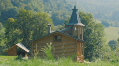 The beautiful wooden house costs on the fringe of the forest - stock footage