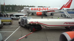 Ground crew fueling truck, Easyjet airplane refuel, Berlin, Germany - stock footage