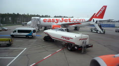Easyjet airplane refuel, ground crew fueling truck, Berlin, Germany Stock Footage