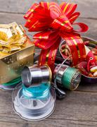 Gift fishing tsckles with red and gold bow Stock Photos