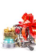 gift fishing tsckles with red and gold bow - stock photo
