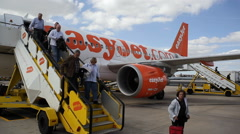 Passengers step off Easyjet Airplane using stairs, Lisbon Airport, Portugal Arkistovideo
