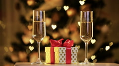 Male and female hand with glasses of champagne on background of festive lights. Stock Footage