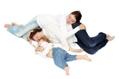 Three person of the family sleeping Stock Photos