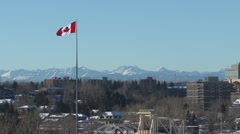 Canada Flag large, with Rocky Mountains, left Stock Footage
