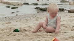 Toddler sitting in the sand at the beach.mov Stock Footage