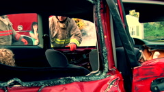 Firefighter helping rescue mother and children from car accident Stock Footage