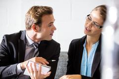 Colleagues talking together Stock Photos