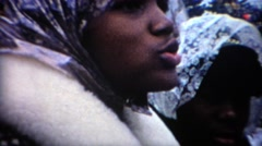 1969: Outdoor stadium sports fan cover up during cold wet weather. WEST Stock Footage