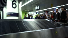 People wait for luggage, baggage claim, Lisbon Airport, Portugal Stock Footage