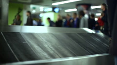 Baggage claim, passengers wait for luggage, Lisbon Airport, Portugal Stock Footage