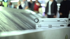 Baggage claim at airport, people collect luggage, Lisbon, Portugal Stock Footage