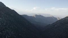 Aerial Push Through Mountain Valley Stock Footage
