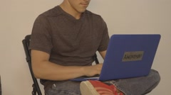 Angled Shot of Young Man on Laptop Labeled Anonymous - stock footage