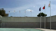 Portuguese flags at Monumento Combatentes Ultramar, memorial, Lisbon Stock Footage