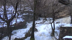 White waters of a torrential waterfall in the winter stock video footage Stock Footage