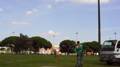 Gardeners in the city mow grass lawn in park, Lisbon, Portugal - stock footage