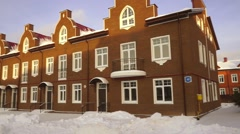 Panoramic establishing shot of red brick townhouses at sunny snowy day - stock footage