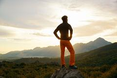 Traveler on the cliff Stock Photos