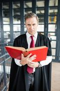 Lawyer reading a book attentively Stock Photos