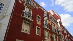 Beautiful old red building, Lisbon, Portugal Stock Footage