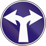 Road sign used in Slovakia - Turn right or left - stock illustration