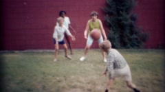 1969: Multicultural kids playing backyard dodgeball. CARMEL, INDIANA Stock Footage