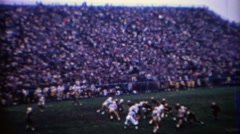 1969: Purdue college football quarterback completes a long pass. WEST LAFAYETTE, Stock Footage
