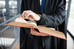 Serious lawyer turning pages of his book Stock Photos