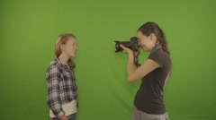 One girl poses as another takes her picture (HD) Stock Footage