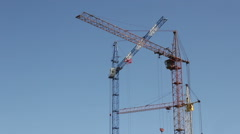 Tower construction cranes against the sky Stock Footage