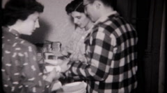 3172 food & drink at the fraternity party - vintage film home movie Stock Footage