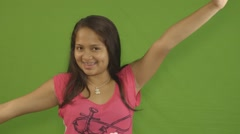 Cute Latina Teenage Girl Waves her Arms in Excitement - stock footage