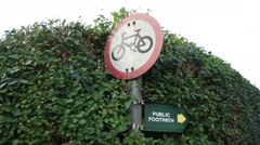 Cycle and footpath sign in England Stock Footage