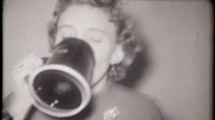 Sorority girl chugs beer at fraternity party - 3173 vintage film home movie Stock Footage