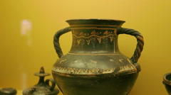 Close-up shot of ancient clay vase decorated with ornament, museum exhibit - stock footage