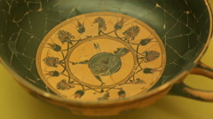 Close-up of ceramic kylix with warrior, ancient Greek pottery at Agora museum Stock Footage