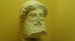 Herm stele head, remains of ancient sculpture for park decoration, Agora museum Stock Footage