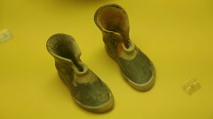 Tiny ceramic shoes on display of Agora Museum, archaeological findings in Greece Stock Footage