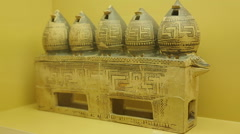 Ancient Greek geometrical art pyxis in shape of granaries, Agora Museum display Stock Footage