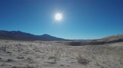 Mojave Desert Sand Mountains Sun- Slow Zoom Stock Footage