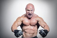 Composite image of aggressive fighter flexing muscles Stock Photos