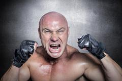 Composite image of angry fighter with gloves Stock Photos
