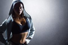 Composite image of portrait of sexy athlete in hood Stock Photos
